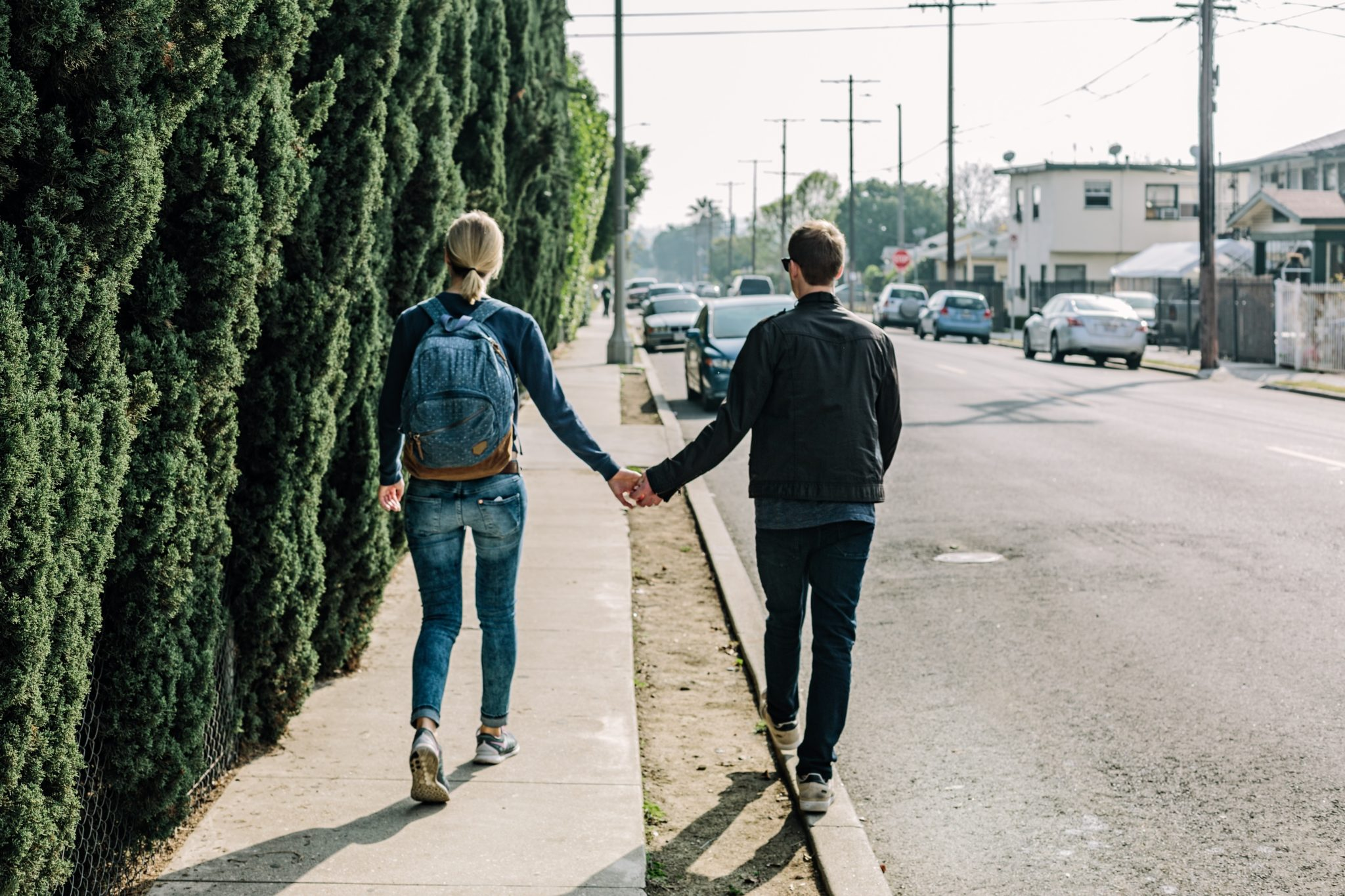 engagement couple holding hands